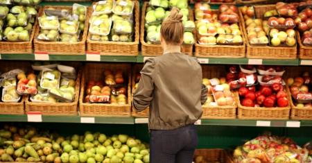 A vegan shopper purchases fresh fruit and vegetables