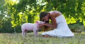 A vegan woman extends warmth and empathy to all animals